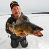 image of Tom Neustrom ice fishing for Walleye