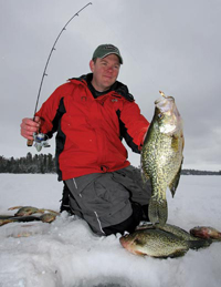 Image of Dan Johnson with Crappies on ice