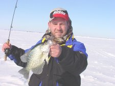 image of ice fisherman with big crappie