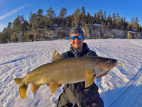 image of dylan maki with big lake trout