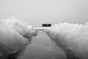 image of ice fishing shelter in standing water