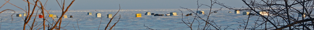 image of ice fishing shelters on lake mille lacs