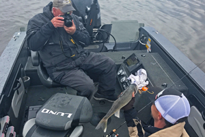 image of photographer taking picture of walleye