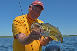 image of Brian and Will Rusch netting Walleye