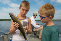 image of young boys examing Walleye