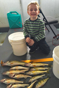 image of youngster with walleyes