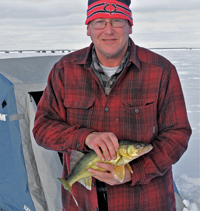image of dennis rule with red lake walleye