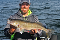 image of scott moe with lake mille lacs walleye