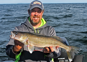 image of scott moe with mille lacs walleye