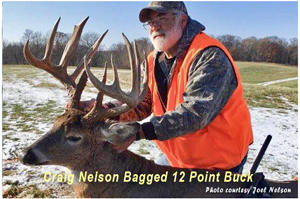 image of Craig Nelson with 12 point buck