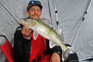 image of justin bailey with red lake walleye