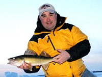 image of Tom Batuik holding Walleye