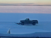 image of truck plowing snow on Bowstring Lake