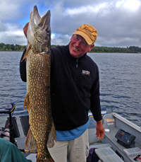 image of Jeff Sundin holding monster pike on fishing trip