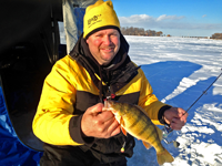 Jon Thelen showing Perch caught while ice fishing