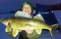 Image of Caden Carpenter holding large Walleye