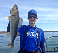 image of Nate Thelen holding Walleye from Lake MilleLacs