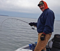 image of Rick Hastings reeling in fish