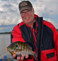 image of rand olson with giant bluegill