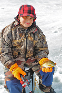 image of ice fishing kid holding sunfish