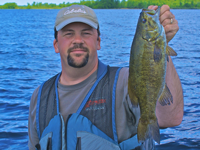 image of Brian Castellano holding nice Smallmouth Bass