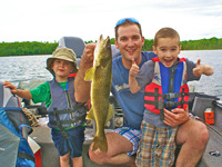 image of Johnny holding noce walleye and giving thumbs up