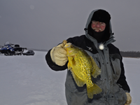 image of Bill Powell holding big Crappie on the ice