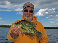 image of Terry Brock holding big Crappie