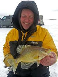 image of Crappie Fishing Guide Jeff Sundin holding Crappie on the ice