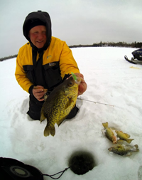 image of fishing pro Jeff Sundin with slab Crappie on ice