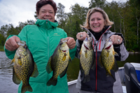 image of Kendra Olson and friend holding large Crappies