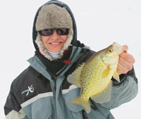 image of Travis DeWitt holding Bowstring Lake Crappie