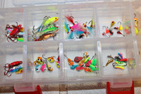 image of tackle box filled with ice fishing lures and jigs