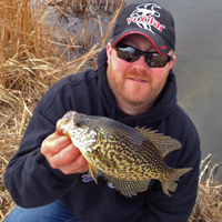 image of Ray Welle holding Crappie