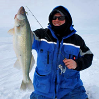 image of Brett McComas holding Lake Winnipeg Walleye