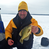 image of Jon Thelen with Crappie on ice