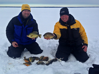 image of Jon Thelen and Jeff Sundin with nice catch of panfish