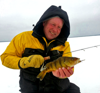 image of fishing guide jeff sundin holding perch on ice