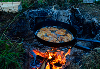 image of Bluegills cooking on fire