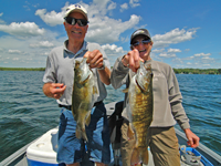 image of Jim and Jan Bopp with a pair of nice Smallmouth Bass