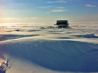 image of pickup truck stuck in deep snow on the ice