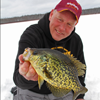 image of Jeff Sundin with Crappie on ice