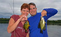 image of Tammi and Chase Norton with crappie and sunfish