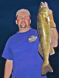 image of Briand Castellano holding big Walleye