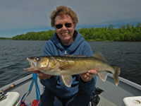 image of Judy Gandy holding large Walleye
