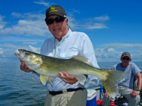 image of Bill Linder holding nice red lake walleye