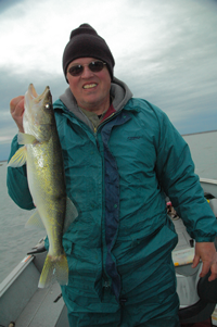 Image of Dave Olson with large Leech Lake Walleye