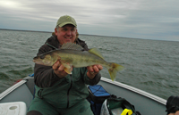 image of Kevin Scott with Leech Lake Walleye