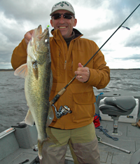 image of Tim Vaughn with large Walleye