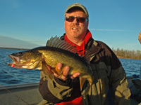 image of Tom Cashman with big Walleye